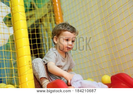 Child is playing in a toy house