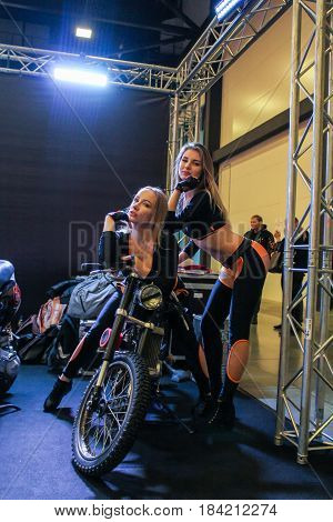 St. Petersburg Russia - 15 April, Girls with a motorcycle,15 April, 2017. International Motor Show IMIS-2017 in Expoforurum. Models on motorcycles presented at the motor show.