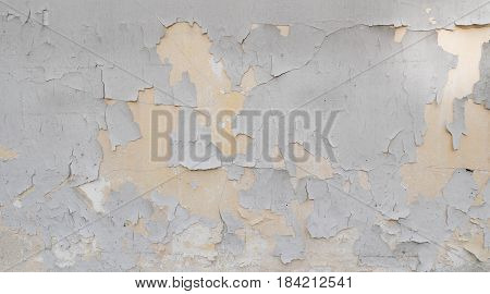 The old wall have cracked . It's showed about the olded of wall. the light brown cracked wall .