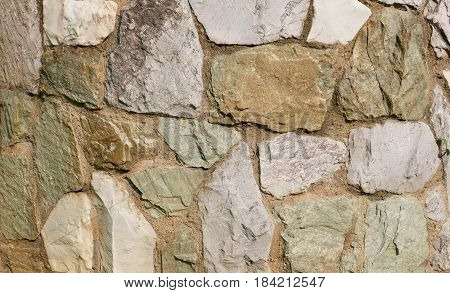 The wall of natural stone. Rocks stone wall texture background.