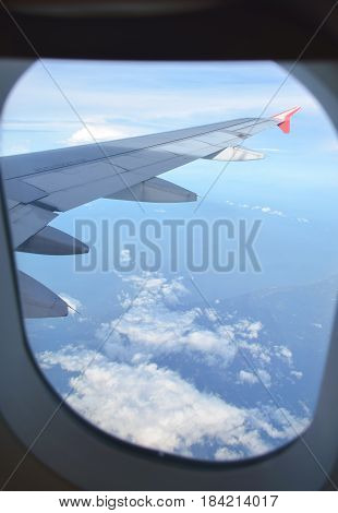 See Through Airplane's Window For Clounds And Wing