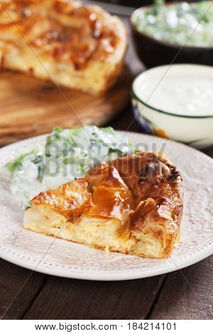 Phyllo pastry cheese pie served with salad and yogurt