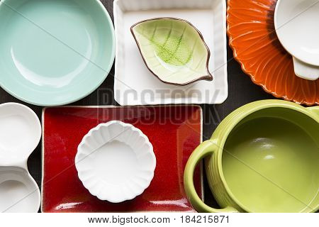 Various colorful dishes close up as background