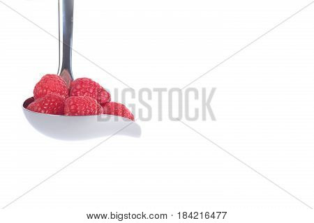 Raspberries in saus cutlery and isolated on white