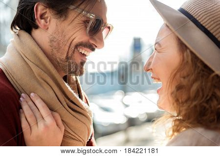 Love at first sight. Mature boyfriend and girlfriend on the street. They are laughing, flirting and looking at each other with joy