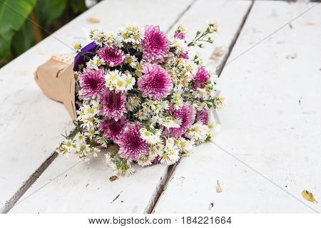 Bunch of flowers gift on white floor