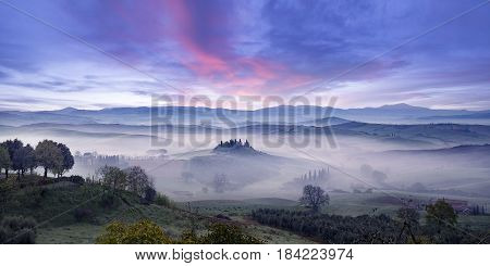 panoramic view of the fog in the Orcia valley at sunrise Tuscany