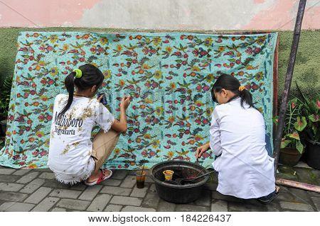 Woman Making Batik At Yogyakarta In Indonesia
