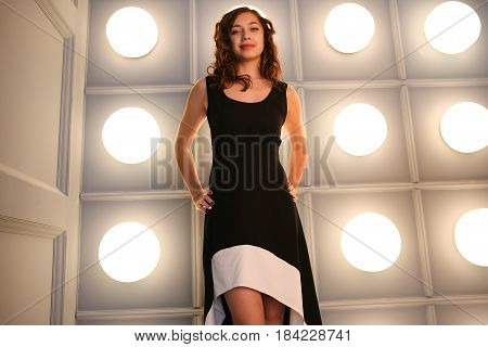 Image the girl in a black dress in full length. low angle