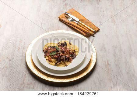 ravioli with ham red chicory and sage