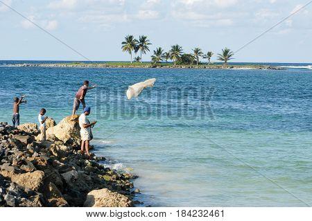 Fisherman Throwing A Fishing Net Into The Sea