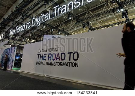 Hannover Germany - March 22 2017: White wall with a slogan about the digital transformation at CeBIT 2017. CeBIT is the world's largest trade fair for information technology.