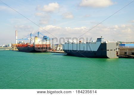 View on the port of Civitavecchia with ships and port cranes Italy.