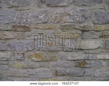 Pattern gray color of modern style. Antique natural stonewall. Stone wall surface with cement. Stones or blocks.