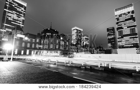 TOKYO, JAPAN - APRIL 11, 2017 - Building office lights glow at night near Tokyo Station in the heart of the sleepless metropolitan city
