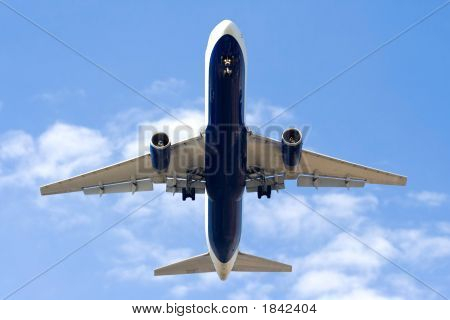 Aircraft taking off in blue sky with clouds poster