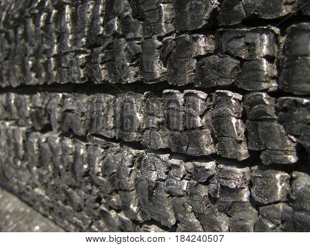 Natural wood charcoal Isolated on white, hardwood charcoal. Details on the surface of charcoal. Black charcoal texture background.