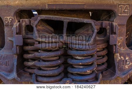 Close-up of rusted springs on freight train boxcar Sterling Colorado