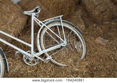 Old bicycle with hay bale with retro effect