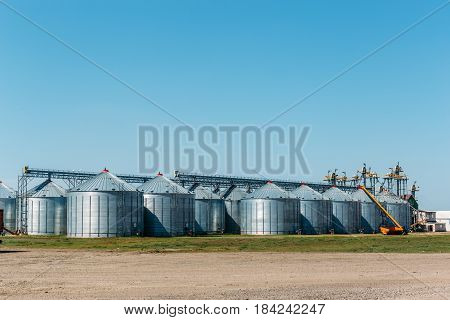 Big industrial Silo Storage Tanks on blue sky background for copy space. Storage Compartment, Agriculture warehouses