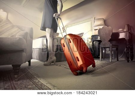 trolley bag in hotel room