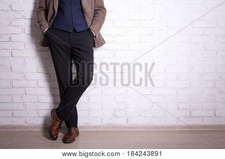 Close Up Of Male Legs In Business Suit And Shoes