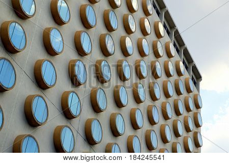 Travel to Bangkok Thailand. The fragment of a building with round windows.