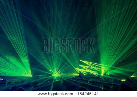 People on the party enjoying concert, dancing in the night club, celebrating new year eve,