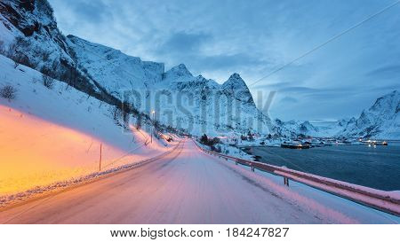 Winter road to Reine fishing village in the Lofoten islands winter time