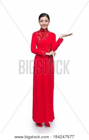 Full Body Of Charming Vietnamese Woman In Ao Dai Traditional Dress Present Something