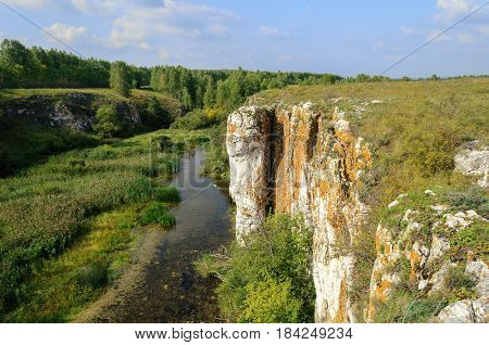 Summer mountain landscape - Ustinovskii Canyon in Southern Urals Russia, summer nature view of mountain landscape. Mountain cliff in summer sunny day. Summer mountain background - natural summer mountain landscape view