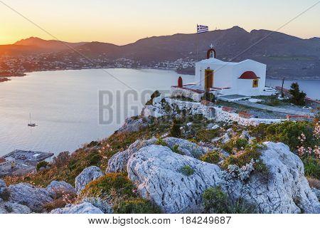 Church over Agia Marina village on Leros island in Greece at sunset.