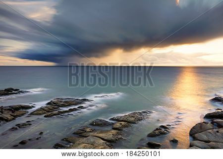 Long exposure of sea and sunset in Tip Of Borneo, Kudat, Sabah Borneo, Malaysia.