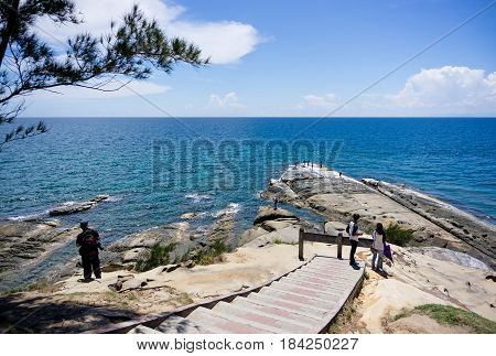 KUDAT, SABAH MALAYSIA - APRIL 23, 2017: Tourists at Tip of Borneo, the northern-most tip is the meeting point of two big oceans, South China Sea and Sulu Sea.