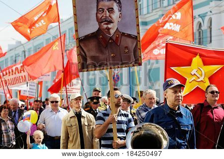 Orel Russia - May 1 2017: May demonstration. People marching with Stalin portrait and red Communist flags around
