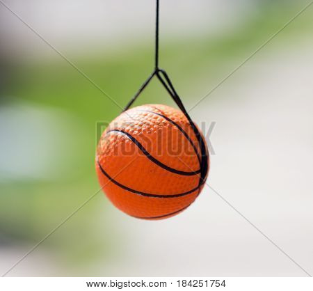 Little ball for the game hanging on the rope .