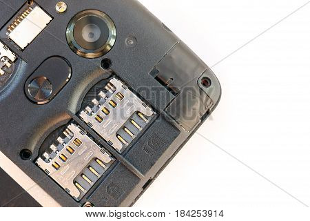 Mobile phone or smartphone without back cover, SIM card slots on white background