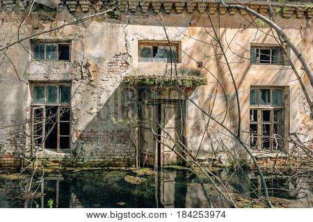 Abandoned building exterior, Water flooded old house