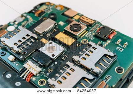 Disassembled mobile phone or smartphone on repair, fixing phone concept
