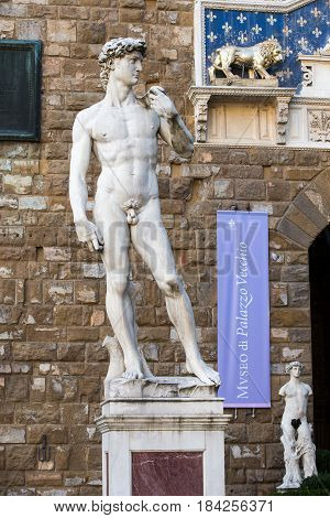 FLORENCE ITALY - July 30 2015: Copy of the statue of David by Michelangelo on the Piazza della Signoria in Florence Italy where the original David stood after being completed in 1504 AD. Applicable concepts could include Art History Beauty Travel others.