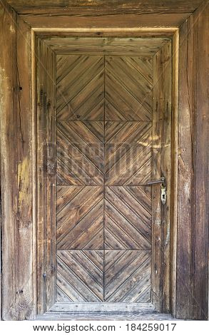 Wooden door to an old country cottage
