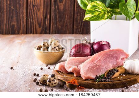 Raw Pork Meat With Several Spices And Vegetable