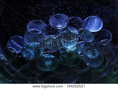 Decoration glass stones under water with air bubbles. Abstraction