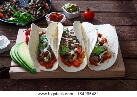 Fajitas, mexican beef with grilled vegetable in tortilla wraps.