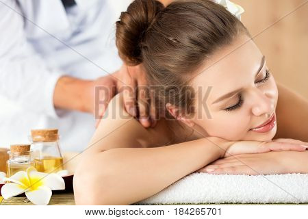 Beautiful Young Woman Laying At Spa Salon