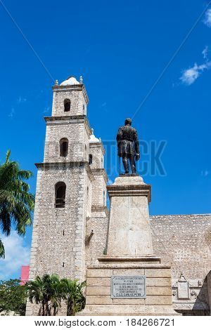 Statue And Church In Merida