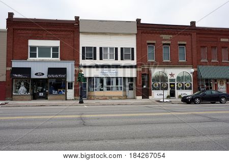 KALKASKA, MICHIGAN / UNITED STATES - NOVEMBER 27, 2016: Family of God Christian Fellowship offers worship services in downtown Kalkaska, and has a store for rent.