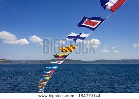 Set of the marine alarm flags on a mast.