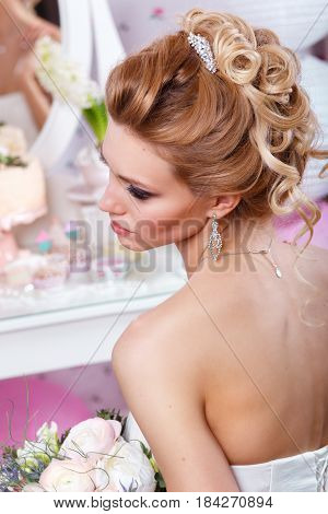 Beautiful bride with fashion wedding hairstyle . Hairstyle back view. Wedding concept