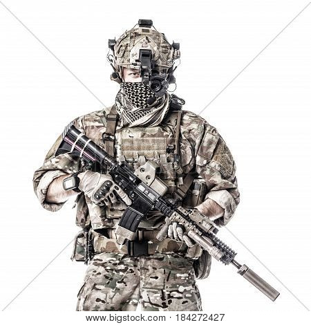 Army Ranger in field Uniforms with weapon, plate carrier and combat helmet are on, his face closed by Shemagh Kufiya scarf. Studio shot